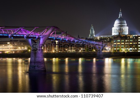 View of the Millennium Bridge towards St Paul's Cathedral London - stock photo