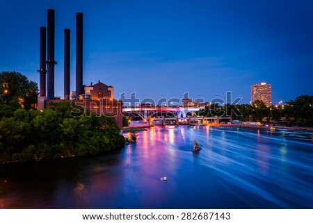 View of the Mississippi River from the Stone Arch Bridge at night in Minneapolis, Minnesota. - stock photo