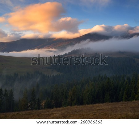 View of the mountain in the clouds. Autumn landscape. Carpathians, Ukraine, Europe - stock photo