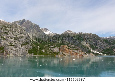 View of the mountains near Johns Hopkins Glacier in Glacier Bay National Park in Alaska - stock photo