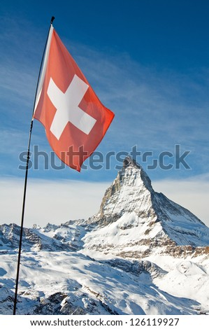 View of the national flag of Switzerland with the Matterhorn in the background - stock photo