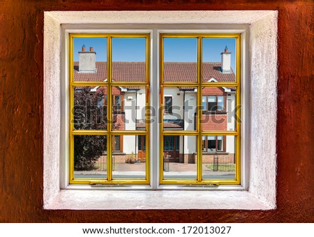 View of the neighborhood through a window - stock photo