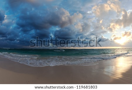 View of the ocean and the sky at sunset - stock photo