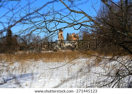 view of the old orthodox church through the bench of trees - stock photo