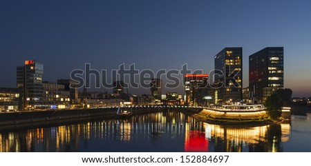"""View of the old quarter """"Zollhafen"""" in Dusseldorf in Germany at night - stock photo"""