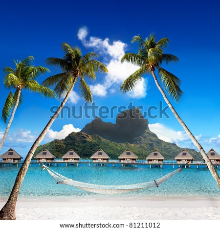 View of the Otemanu mountain through the palms with hammock and ocean. Bora-Bora. Polynesia - stock photo