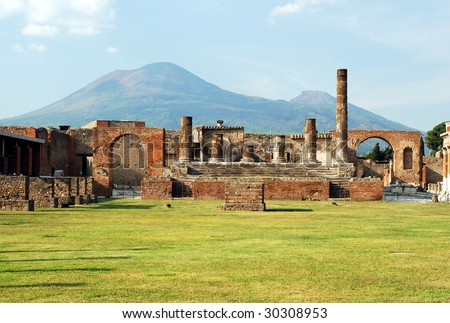 View of the Pompeii ruins in italy with Mount Vesuvius in background. - stock photo