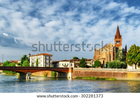 View of the Ponte Navi over the Adige River and the Saints Fermo and Rustico church in Verona, Italy. Verona is a popular tourist destination of Europe. - stock photo