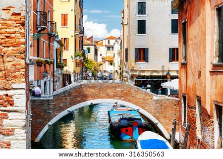 View of the Ponte Ruga Vecchia and the Rio de San Zan Degola Canal from the Ponte de Ruga Bella o del Forner in Venice, Italy. Venice is a popular tourist destination of Europe. - stock photo