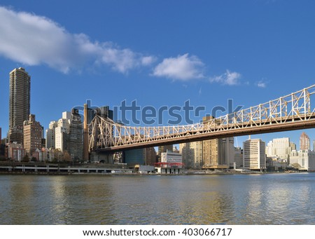 View of the Queensboro Bridge from the Roosevelt Island. - stock photo