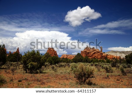 View of the red rock formations in Kodachrome Basin  with blue sky and clouds - stock photo