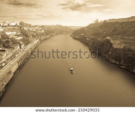 View of the River Douro and waterfronts in the city of Porto. Sunny day. Toned. - stock photo