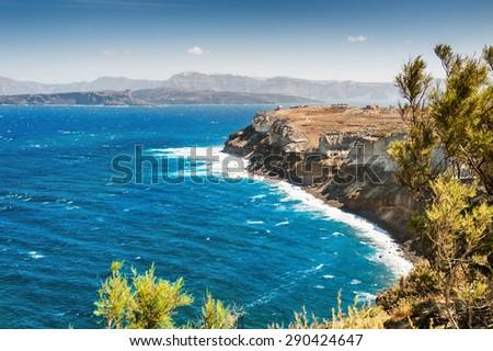 View of the rocky sea coast. Santorini island, Greece. Beautiful summer landscape - stock photo