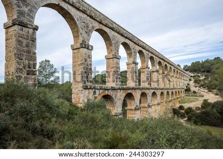 view of the roman aqueduct Pont del Diable, Tarragona, Spain  - stock photo
