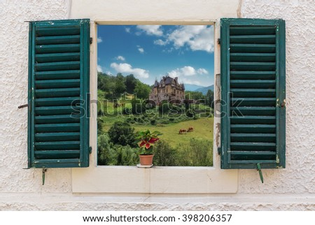 View of the rural landscape through the open window with flower in pots - stock photo