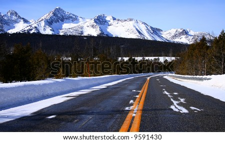 View of the Sawtooth Mountains from Idaho state highway - stock photo