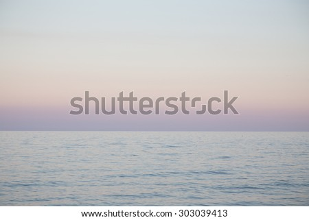 View of the sea on rising in a haze - stock photo
