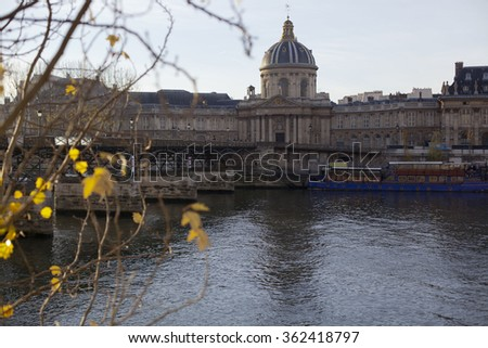 View of the Seine, Pont des Arts, the Institute of France in Paris with autumn trees in the foreground - stock photo