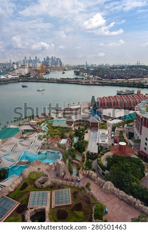 View of the Sentosa island and commercial port of Singapore with a bird eye view. - stock photo