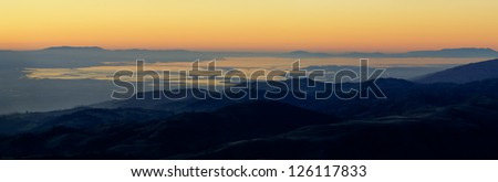 View of the Silicon Valley from Mount Hamilton at sunset. - stock photo