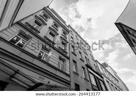 View of the sky from the old courtyard. Black an white. - stock photo
