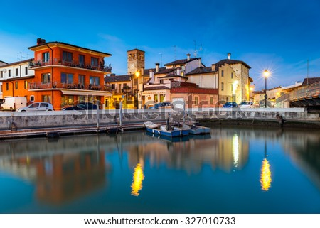View of the small fishing village of Marano Lagunare at sunset. Province of Udine, Friuli Venezia Giulia, Italy - stock photo