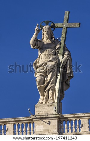 View of the statue of Christ the Redeemer on the balustrade of the baisilica of St. Peter in Rome - stock photo