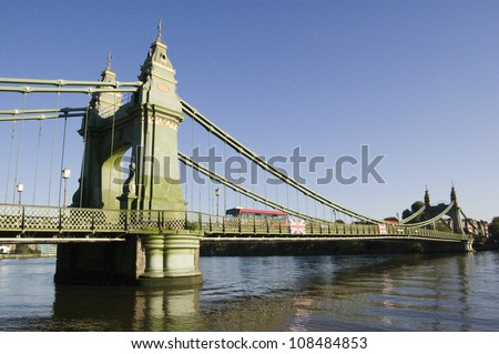 View of the suspension bridge linking Hammersmith to Barnes over the River Thames.  Designed by Joseph Bazalgette and opened in 1887.  It has been attacked by the IRA and Real IRA terrorist groups. - stock photo