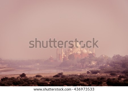 View of the Taj Mahal in India as the sun set.  - stock photo