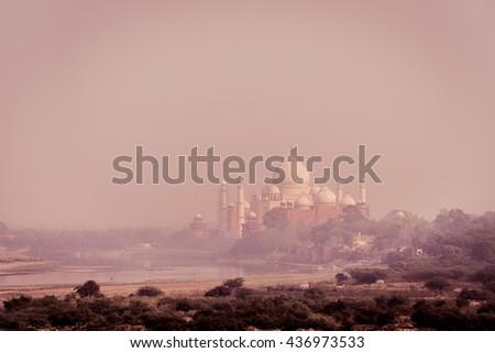 View of the Taj Mahal in India as the sun set.  - stock photo