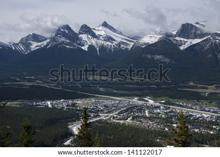 View of the Three Sisters Mountain Range. Picture taken on the Lady Macdonald Hiking Trail. Canmore, Alberta, Canada - stock photo