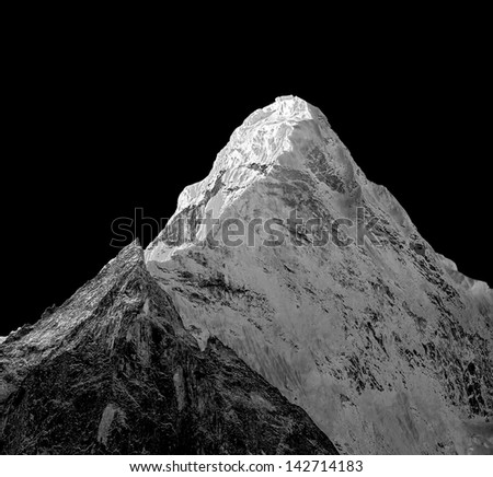 View of the top of the Ama Dablam (6814 m) from the valley of the Chukkhung - Nepal, Himalayas (black and white) - stock photo