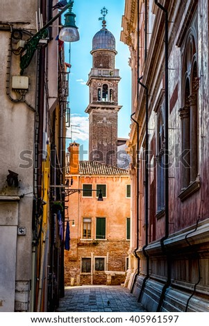View of the tower of St. Mark Cathedral from a back alley in Venice, Italy - stock photo