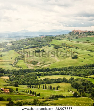 View of the town of Pienza with the typical Tuscan hills from locality of Monticchiello. - stock photo