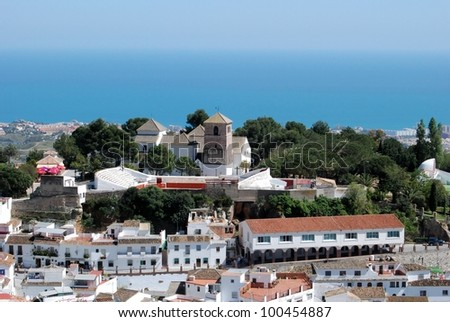 View of the towns church (The Immaculate Conception ) and bullring with the sea to the rear, Mijas, Costa del Sol, Malaga Province, Andalusia, Spain, Western Europe. - stock photo