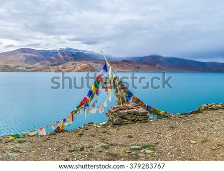 View of the Tso Moriri lake near Karzok village in Rupshu valley against the background of cloudly sky - Tibet, Leh district, Ladakh, Himalayas, Jammu and Kashmir, Northern India - stock photo