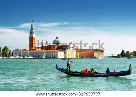 View of the Venetian Lagoon with gondola and the Church of San Giorgio Maggiore on island of the same name in Venice, Italy. Venice is a popular tourist destination of Europe. - stock photo