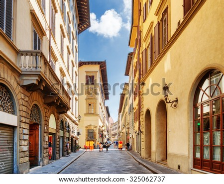 View of the Via dei Banchi street and old medieval houses at historic center of Florence, Tuscany, Italy. Florence is a popular tourist destination of Europe. - stock photo
