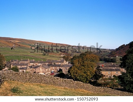 View of the village and surrounding countryside, Thwaite, Yorkshire Dales, North Yorkshire, England, UK, Great Britain, Western Europe. - stock photo