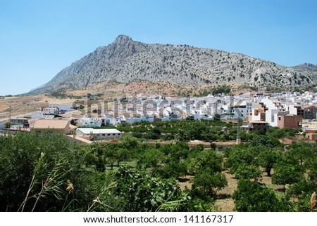 View of the village with mountain to the rear, Valle De Abdalajis (Between Antequera and Alora), Costa del Sol, Malaga Province, Andalucia, Spain, Western Europe. - stock photo