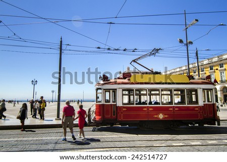 View of the vintage famous red electrical trams circulating still today in Lisbon, Portugal. - stock photo