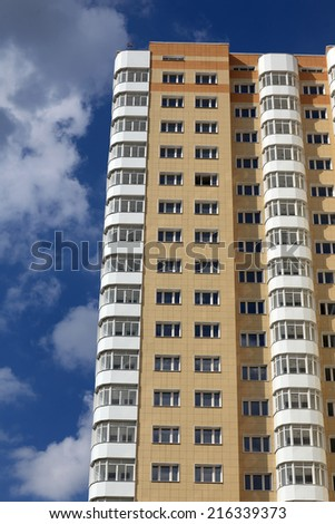 View of the yellow apartment building house - stock photo
