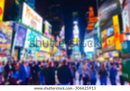 View of Times Square at night in New York City with blurred effect - stock photo
