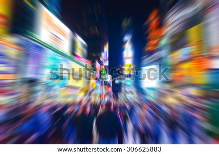 View of Times Square at night in New York City with motion effect - stock photo