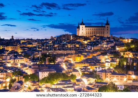 View of Toledo, Spain including Alcazar and the cathedral at dusk. - stock photo