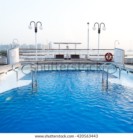 View of top deck of cruise ship with pool. - stock photo