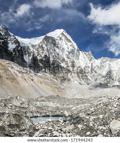 View of top of the peak Langtern (6712 m) from Khumbu glacier - Everest region, Nepal, Himalayas - stock photo
