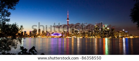 View of Toronto cityscape at night taken from Central Island. - stock photo