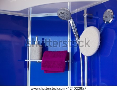 View of towel liquid soap and shower head - stock photo