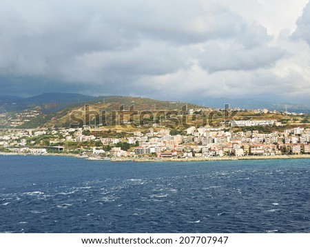 view of town Reggio di Calabria from Strait of Messina, Italy in summer day - stock photo